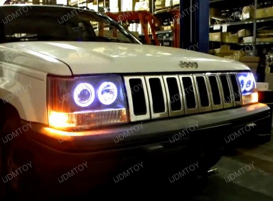 93-98 jeep grand cherokee black housing dual projector headlights